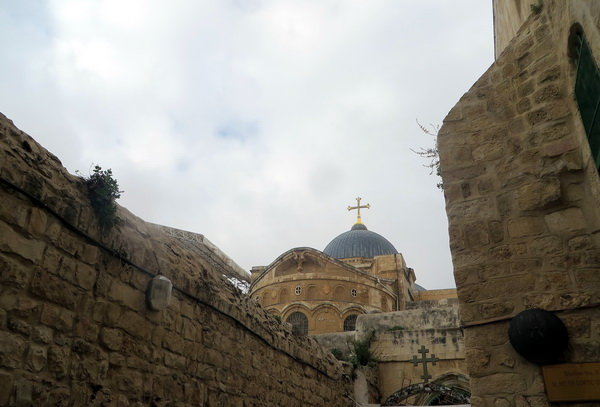 On the Via Dolorosa (way of the Cross) in Jerusalem, with a view of the Church of the Holy Sepulchre.